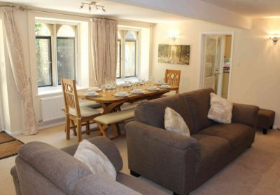 Comfy sofas & chairs in both reception rooms