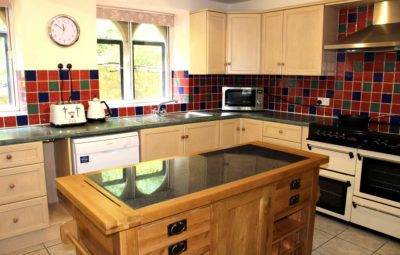 Kitchen fully equipped for twelve guests, includes dishwasher, american style fridge freezer, double oven & microwave. Separate utility area with washing machine & tumble dryer