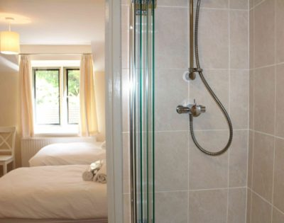 Power shower in the master ensuite. Complimentary toiletries, soft fluffy white towels, robes & slippers all provided