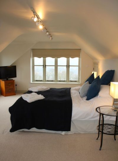 The Retreat - First floor master double bedroom complete with TV and ensuite with bath and shower