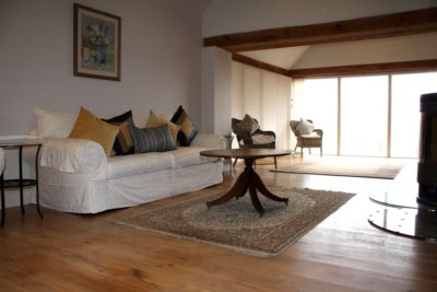 The Retreat - a light, spacious and comfortable sitting room to relax in
