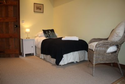 The Retreat - bathroom with bath and shower cubicle is adjacent to bedroom situated on the ground floor
