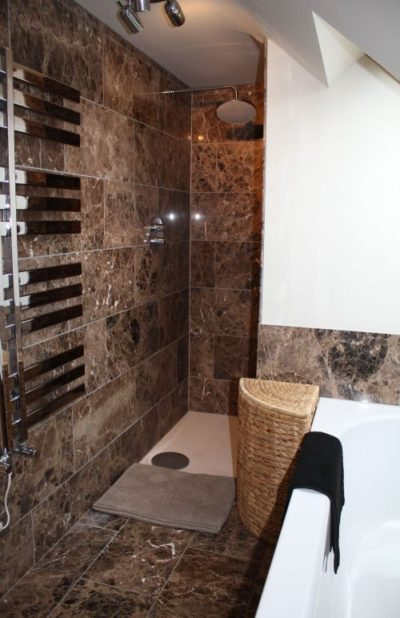 The Retreat - first floor ensuite to master bedroom with shower and bath