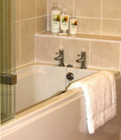 Two bathrooms with shower over & extra cloackroom on the ground floor